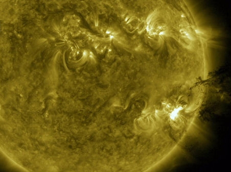 NASA Science News - frame from ultraviolet movie of the explosion shows a 'solar tsunami' wave